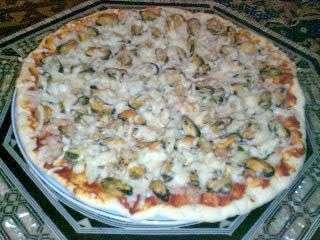 pizza aux fruits de mer recette ptitchef. Black Bedroom Furniture Sets. Home Design Ideas